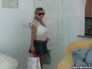 Granny with large breasts masturbates in hose
